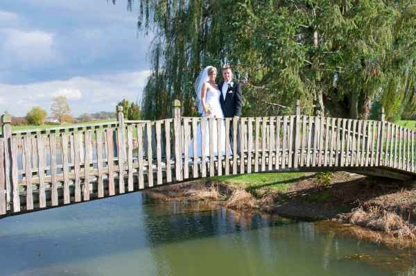 Bride & groom on bridge to island