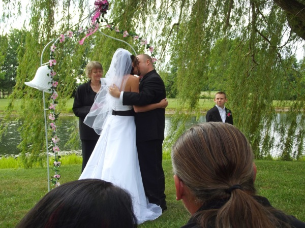 Image of bride & groom kissing