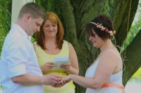 Image of a bride and groom saying their vows